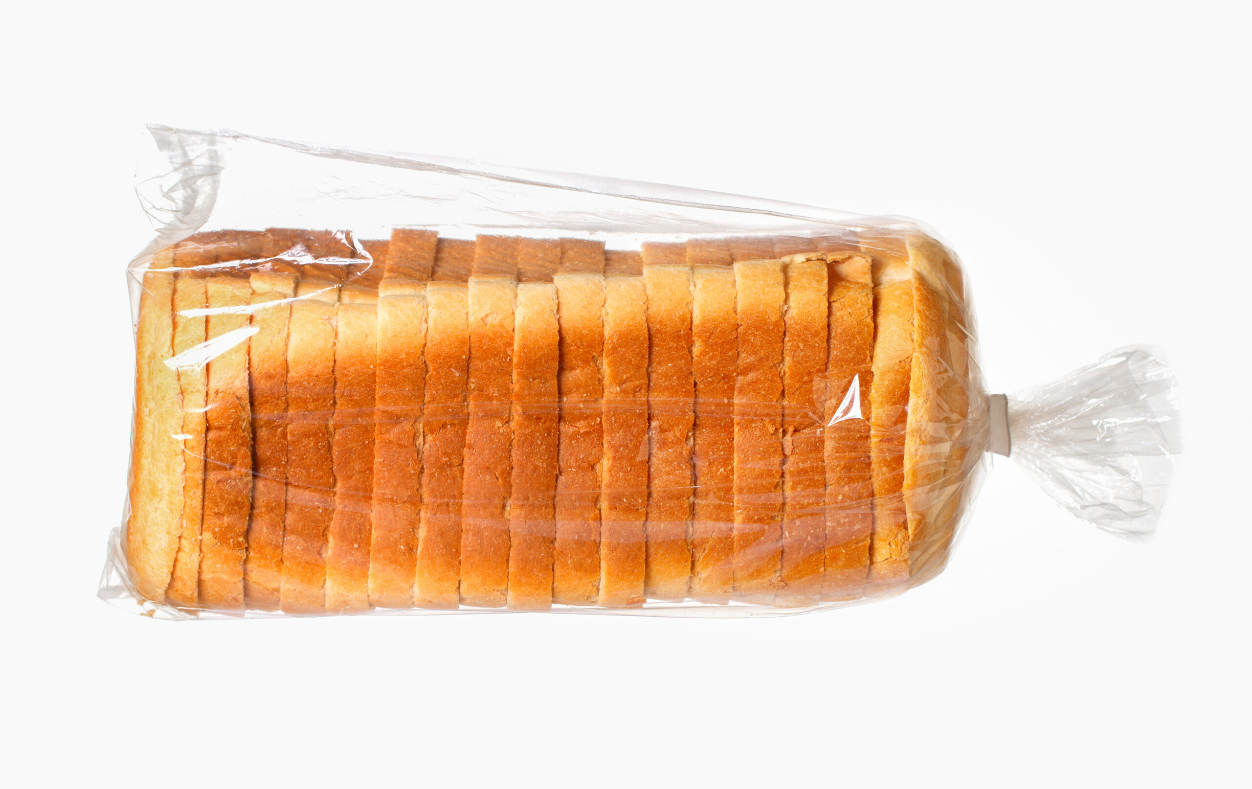 Sliced bread on white surface.